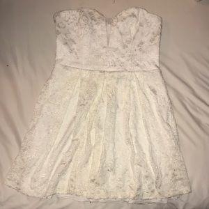 Strapless white lace mini dress